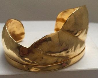 Gold plated brass wave cuff bracelet.