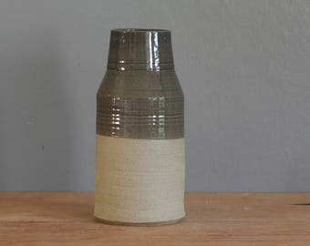 ready made vase. sand colored stoneware clay pottery with slate grey glaze