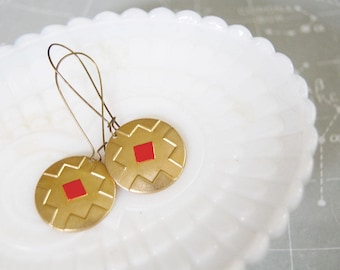 round southwest desert style brass earrings- long kidney wire- red-orange enamel detail