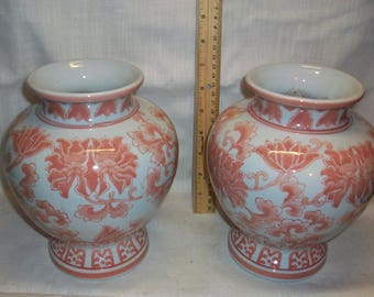 Listing 227 is a Pair of floral porcelain vases