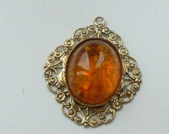 Filigree metal amber glass pendant