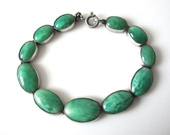 Vintage German Graduated Mottled Green Glass Cabochon Bracelet