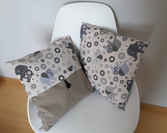 Pillow cover with patterns of little elephants in beige and grey, perfect for a birthday gift, to decorate a children's room