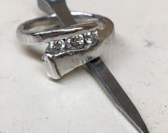 Horse shoe nail diamond engagement ring