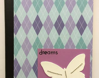 """Embellished Notebook - Purples and Teal Argyle Paper with a Purple Chipboard Butterfly with Silver Sparkles and the Word """"dreams"""""""