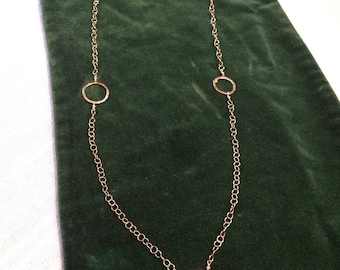necklace of sterling silver chain and hammered fine silver circles.