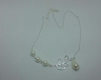 Beautiful silver and pearl necklace with silver leaf accent and silver chain