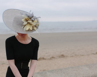 Large feathered saucer hat