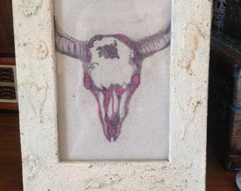 Cow skull in frame