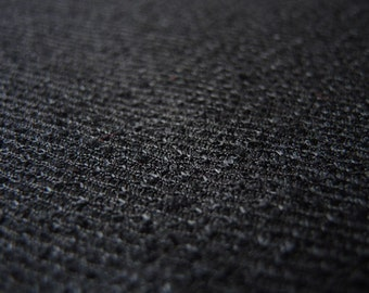 Vintage 1980s black polyester nubby knit fabric disco era 60 inches wide