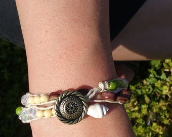 Wrap bracelet with stones like pearl and tigers eye and shells