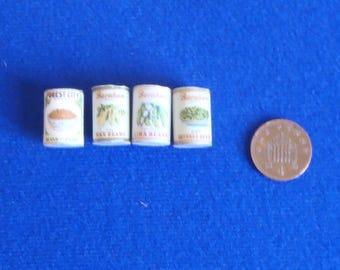 One sixth scale, or play scale, miniature vintage food cans.