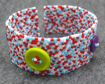 SALE Beaded Cuff Bracelet - Red Turquoise Blue White with Lime Green and Purple Buttons by randomcreative on Etsy