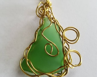 Green sea glass wire wrapped pendant necklace.