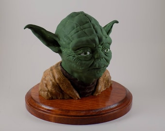 Large Yoda bust on stained wood base