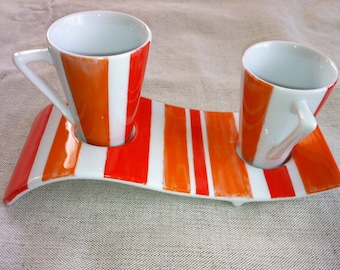 Duo of red and orange striped porcelain coffee cups