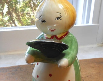 Anthropomorphic Veggie Head Lady holding Measuring Spoons