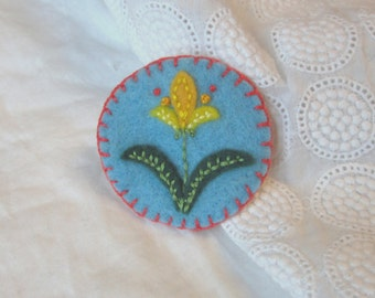 Embroidered  felt brooch, light blue with yellow spring flower