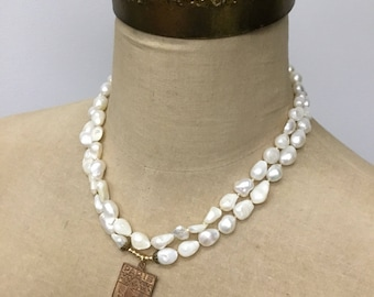 Freshwater pearl necklace with Paris pendant