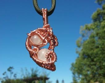 copper and rose quartz pendant