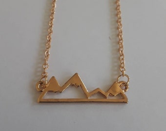 Snowy mountain top gold charm necklace