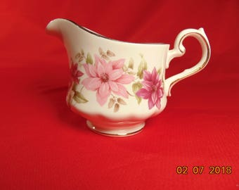 "One (1), 3"", 6 oz. Bone China, Creamer, from Queen Anne, of England, in the 8545 Floral Pattern."