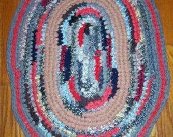 Hand crocheted multi-color oval rug; scrap or rag rug