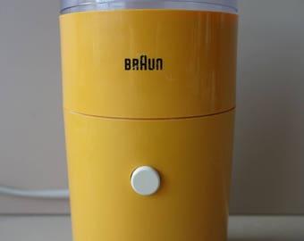 Iconic Braun coffee grinder designed by Reinhold Weiss Braun West Germany 1966 modern design ochre yellow mid century minimalism electronic