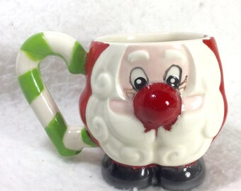 Santa Claus coffee mug candy cane handle big nose, left handed. Free ship to US.