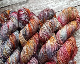 Kerfuffle. A striking yarn with colours including oranges, reds, purples, greys and black.