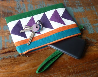 Mini clutch with removable wrist strap / / toiletry bag / / graphic patchwork in shades of purple / / unique / / gift for her