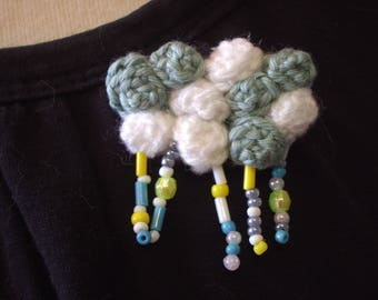 crocheted blue and white rainy cloud brooch