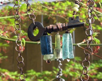 Rusted antique key and ancient roman glass necklace