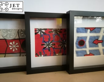 Set of three board game themed framed prints / artworks