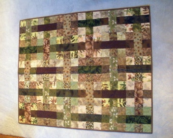 Quilted wallhanging in brown, tans, greens