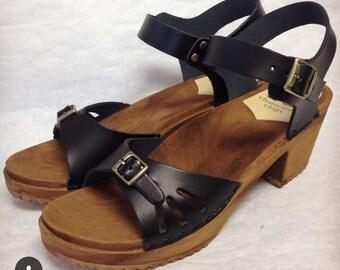 Black sandal clog with buckled ankle strap