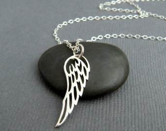 """small silver angel wing necklace. sterling silver. sweet. angelic charm. spiritual pendant everyday simple faith jewelry delicate dainty. 1"""""""