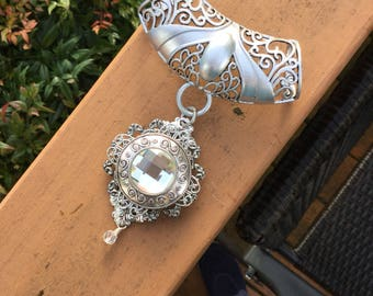 Silver scarf Jewelry with three layers of varios shades a styles of silver filigree centerpiece round faceted clear glass crystal.