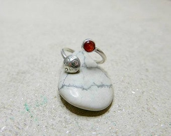 Sun and moon ring. Sterling silver ring set with sunstone.