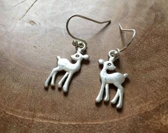 Oh Deer - silvertone dangling earrings with metal silvertone deer - mirrored pair and very cute.