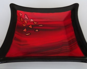 Fused glass dish in red and black with dichroic accents