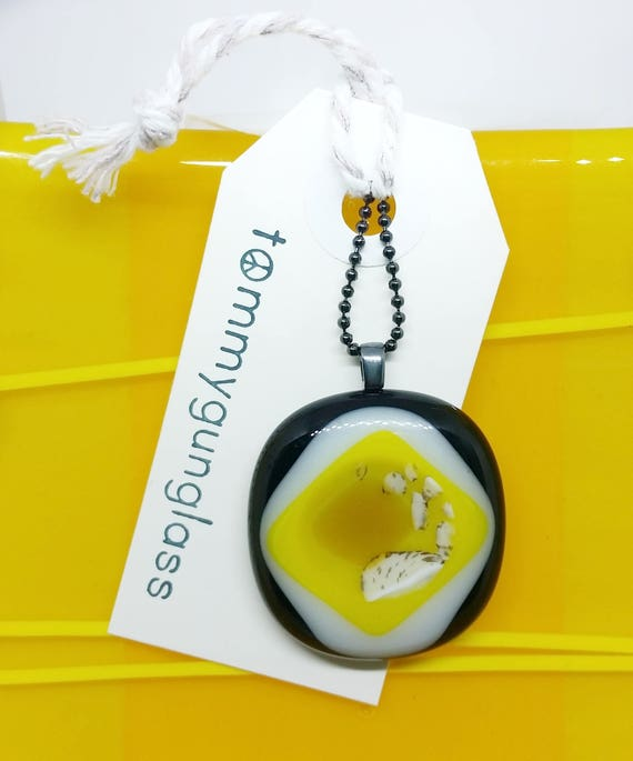 Yellow, Black, and White Glass Pendant on Silver Chain