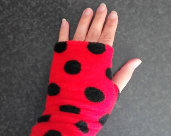 Red fleece fingerless gloves with black dots