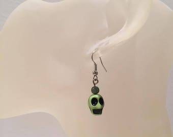 Green skull earrings