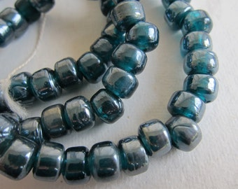 "9x7mm, Handmade Glass Crow Beads, Grey-Blue Luster - Available in 1/2 & Full (24"")  Strand Lengths"