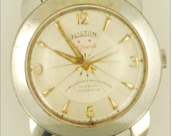 Hilton vintage wrist watch, 25 Jewels, stainless steel water resistant case, silver-white metal dial with wheel design