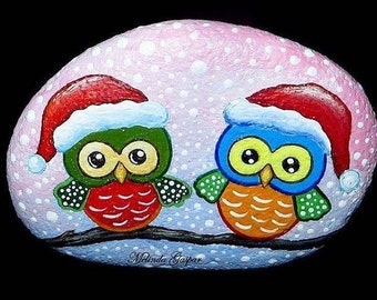 Hand painted rock with Christmas owls and snow