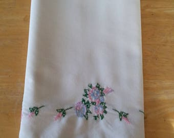Hand embroidered pillow case with scalloped lace trim