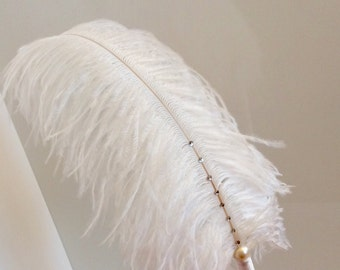 Pen with ostrich feather and ring pillow with lace
