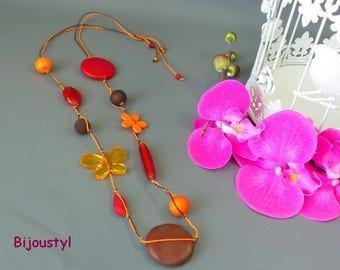 Collier fantaisie long avec ces perles de couleurs orange-rouge-marron
